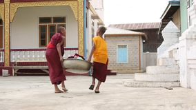 Young Buddhism novices. At Shwe Yan Pyay Temple in Inle. Buddhism is predominantly of the Theravada tradition, practised by 89% of the population stock footage