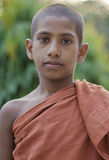 Young buddhist monk. Portrait of young buddhist novice monk in traditional clothes royalty free stock images