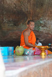 Young Buddhist monk gives advice Royalty Free Stock Photos