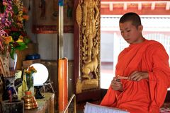 Young Buddhist Monk light incense sticks Royalty Free Stock Photos