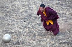 Young buddhist monk playing soccer Stock Photos