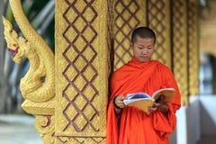 Young Buddhist Monk Reading Prayer Book Stock Photo