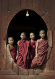 Young Buddhist Monks 1. Young Buddhist monks in the Shwe Yaungwe monastery near Inle Lake, central Myanmar. The monastery is special because of it's oval windows Stock Photography