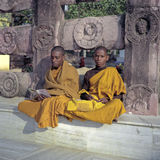 Young Buddhist Monks at the Mahabodhi temple in Bodhgaya. Two young Buddhist Monks at the Mahabodhi Temple complex in Bodhgaya, India Stock Photo