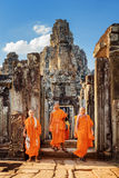 Young Buddhist monks coming out of Bayon temple, Angkor Thom Royalty Free Stock Images