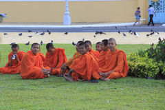 Young Buddhist monks in a garden, Phnom Penh, Cambodia Stock Photos