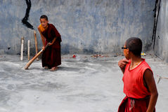 Young buddhist monks playing Cricket Stock Images
