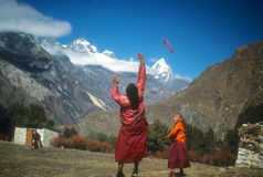 Young Buddhist monks playing frisbee Royalty Free Stock Photo