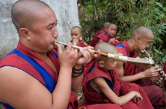 Young Buddhist Monks Playing Horns Stock Photos