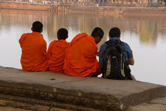 Young Buddhist monks talk with new  friend Stock Image