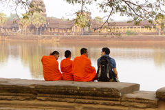 Young Buddhist monks talk with new  friend Stock Images