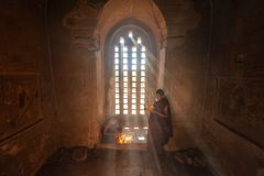 Young Buddhist Novice monk reading in Bagan Myanmar.  royalty free stock photos