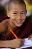 Young Buddhist novice, Myanmar. Young Buddhist novice studying in a monastic school in Mandalay, Myanmar, Burma stock image