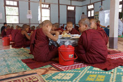 Young Buddhist students eating lunch Royalty Free Stock Photo