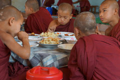 Young Buddhist students eating lunch Stock Photography