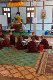 Young Buddhist students eating lunch Royalty Free Stock Images