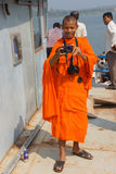 Young Buddhists monk takes pictures Stock Photos