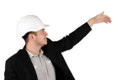 Young builder, architect or engineer pointing Royalty Free Stock Photography