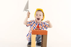 Young builder. Young Boy Builder on white Stock Photo