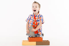 Young builder. Young Boy Builder on white Royalty Free Stock Image