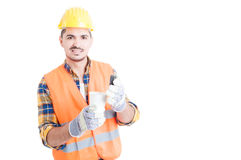Young builder or constructor holding a cup of hot coffee Royalty Free Stock Photos