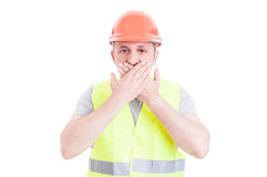 Young builder covering his mouth as silence concept Royalty Free Stock Photography