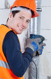 Young builder with drill in hands Royalty Free Stock Photo