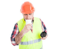 Young builder enjoying the flavor of fresh coffee Stock Images