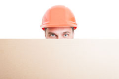 Young builder holding big placard Royalty Free Stock Photos
