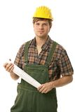 Young builder holding rolled-up floor plan Stock Photography