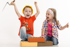 Young builder. Young kids builder on white Royalty Free Stock Photo
