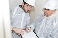 Young builder manager and teacher. Young builder manager and his teacher royalty free stock photos