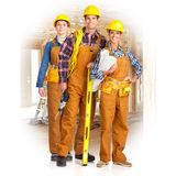 Young builder people. In yellow uniform stock image