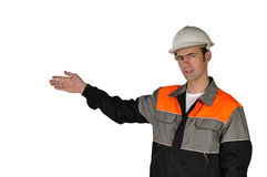 Young builder, pointing to the work done Royalty Free Stock Image