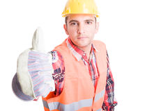 Young builder showing thumbs up Stock Photo