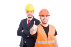 Young builder showing you the thumbs up Stock Images