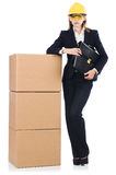 Young builder woman  with boxes Stock Photography