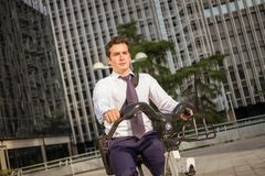Young buinessman riding to work in the city royalty free stock photos