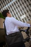 Young buinessman riding to work in the city stock photos
