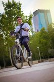 Young buinessman riding to work in the city royalty free stock photography