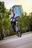 Young buinessman riding to work in the city royalty free stock image
