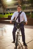 Young buinessman riding to work in the city Stock Photo