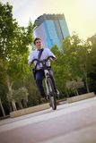 Young buinessman riding to work in the city stock photography