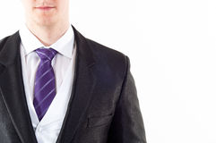 Young buisnessman with purple tie. On white background royalty free stock images