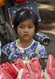 Young Burmese girl selling watermelon Royalty Free Stock Photos
