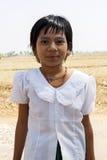 Young Burmese Girl. A young Burmese girl with a white blouse smiling Stock Photos