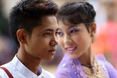 Young Burmese man and woman at novice ceremony, Myanmar Stock Photos