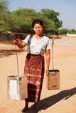 Young burmese woman carrying water Royalty Free Stock Images