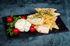 Young burrata cheese. With focaccia bread stock images