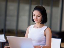 Young busines woman with notebook Stock Photography